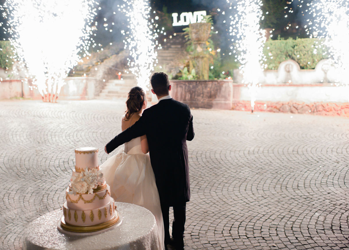 cutting-of-the-wedding-cake-with-sparklers-and-fountains-and-fireworks