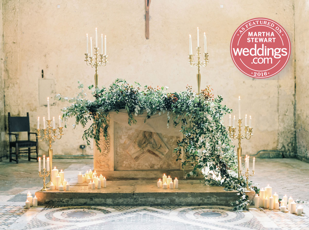Catholic church wedding altar with candelabras and olive branches