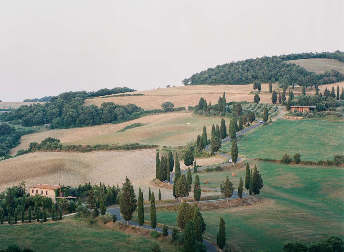 Tuscany-rolling-hills-with-cypress-trees