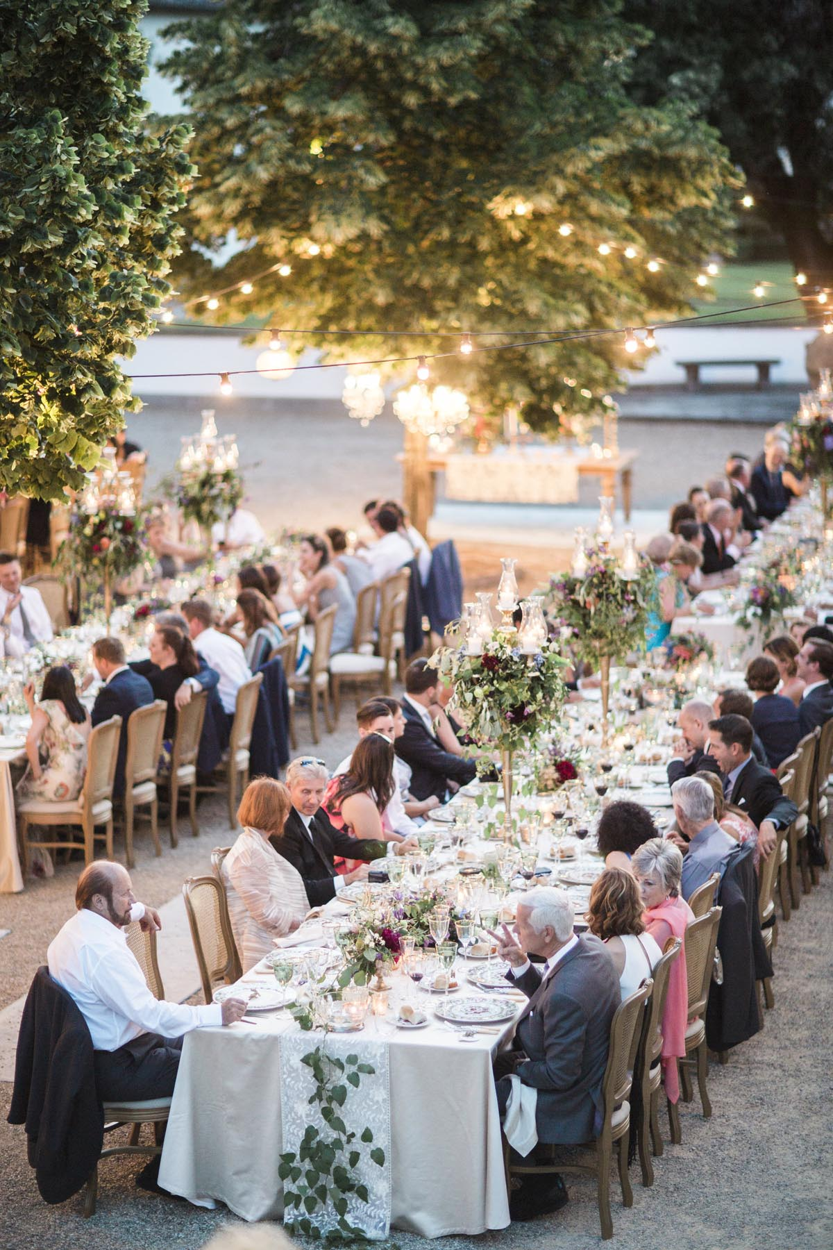 Tuscany vineyard wedding dinner with chandeliers