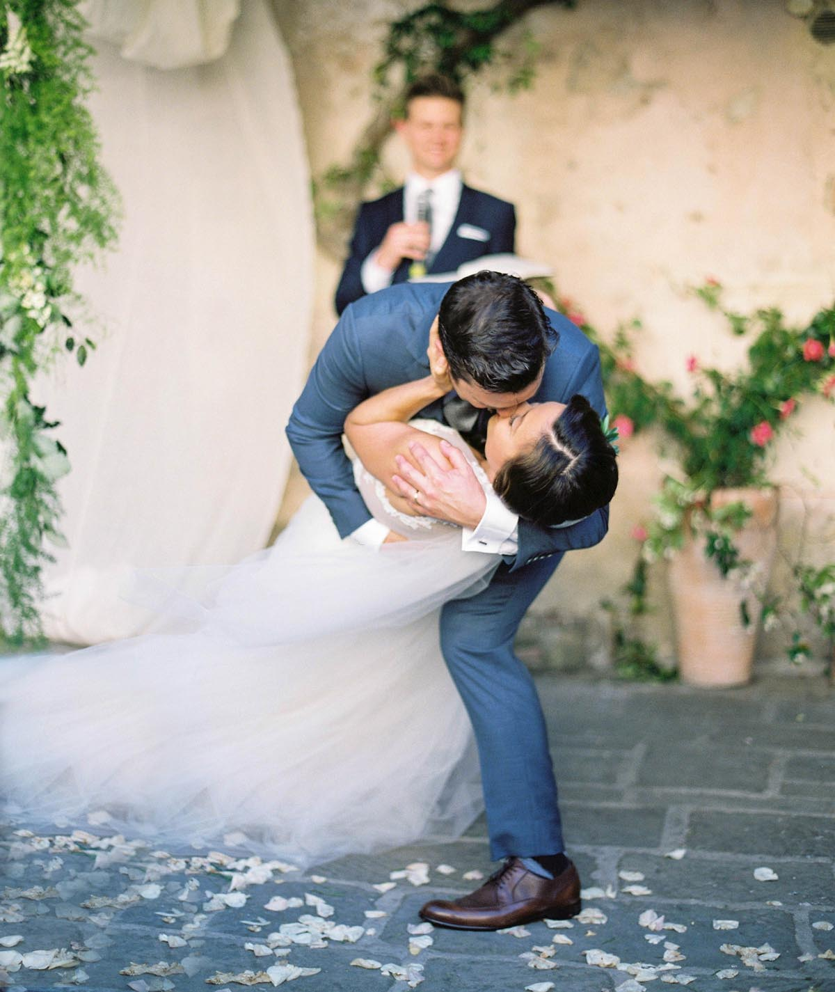 groom-dips-the-bride-after-the-ceremony-as-he-kisses-the-bride