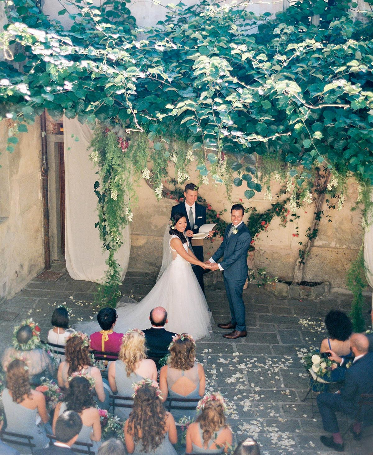 hanging flowers and vines as ceremony altar area in a rustic Tuscan square