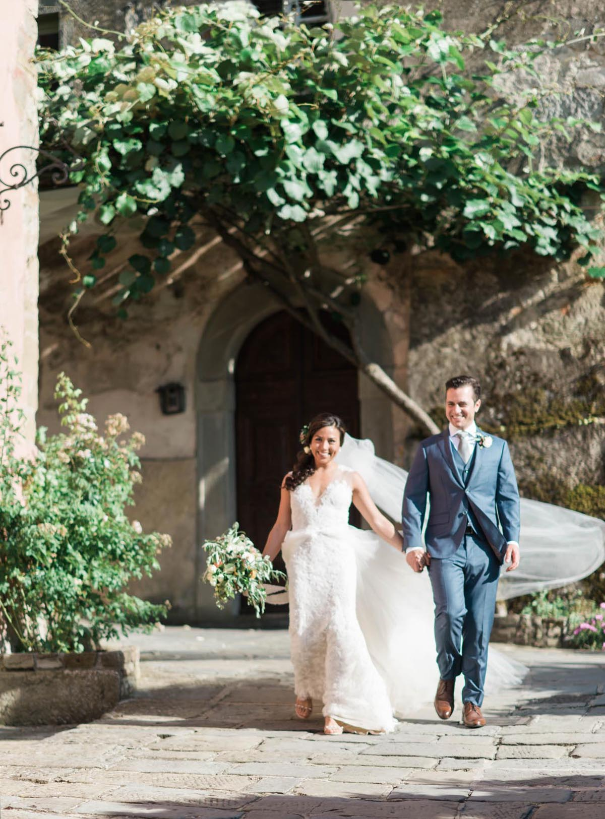 bride and groom exiting the ceremony from a Tuscany vineyard