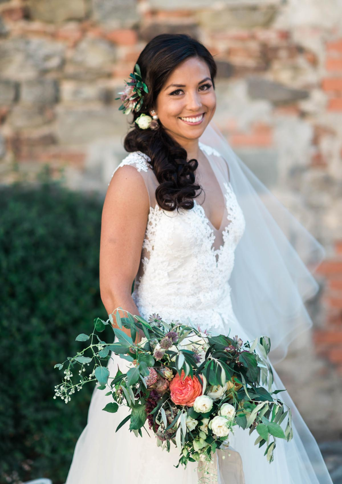 bride-with-loose-bridal-bouquet-with-olive-leaves-and-greens-and-peonies-and-roses