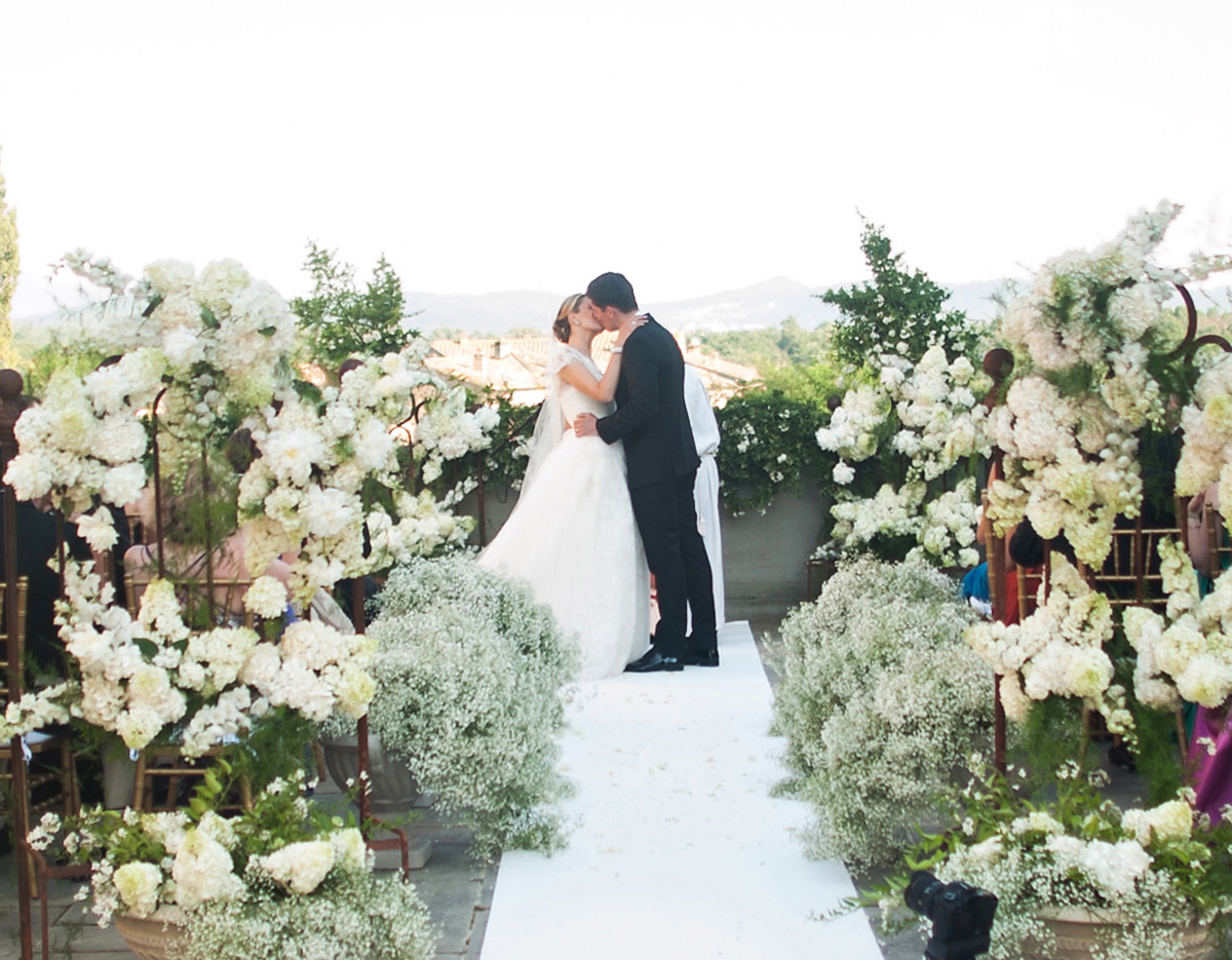 abundant-floral-wedding-ceremony-in-a-tuscan-villa-with-white-carpet-aisle