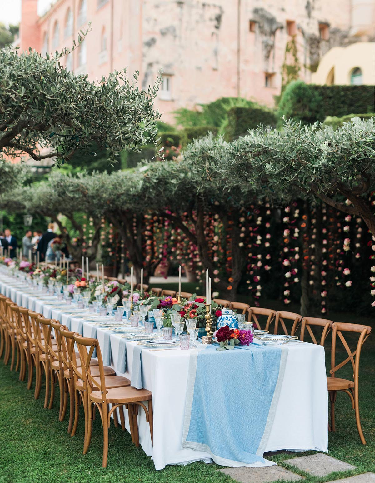 boho chic wedding on the Amalfi Coast in Ravello Italy with hanging flowers from olive trees