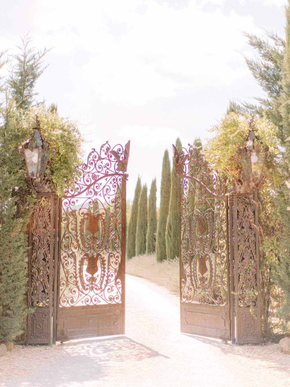 Tuscany-wrought-iron-gates-with-cypress-trees-wedding-venue
