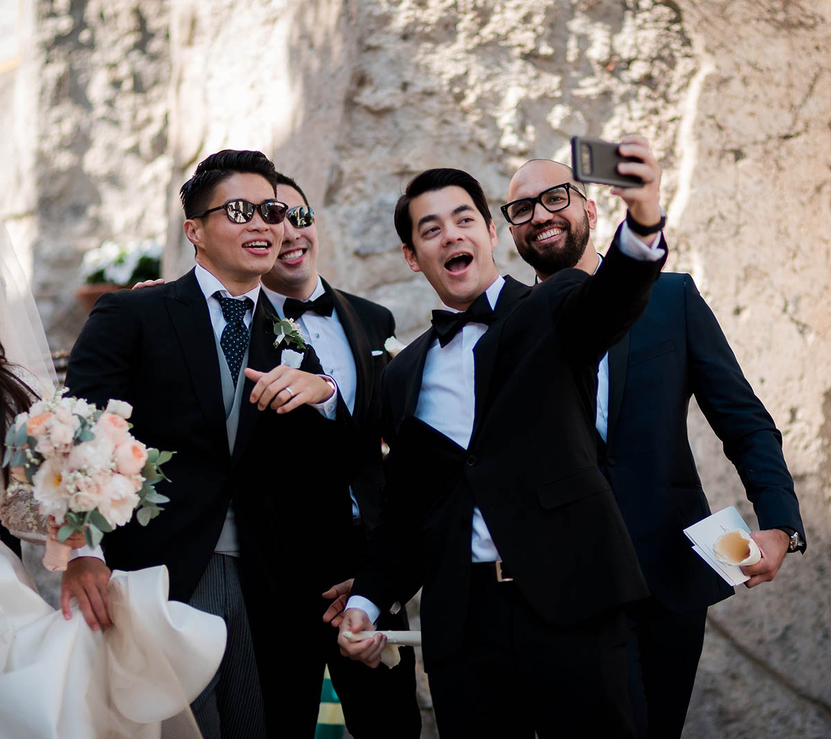 groomsmen with groom taking a selfie