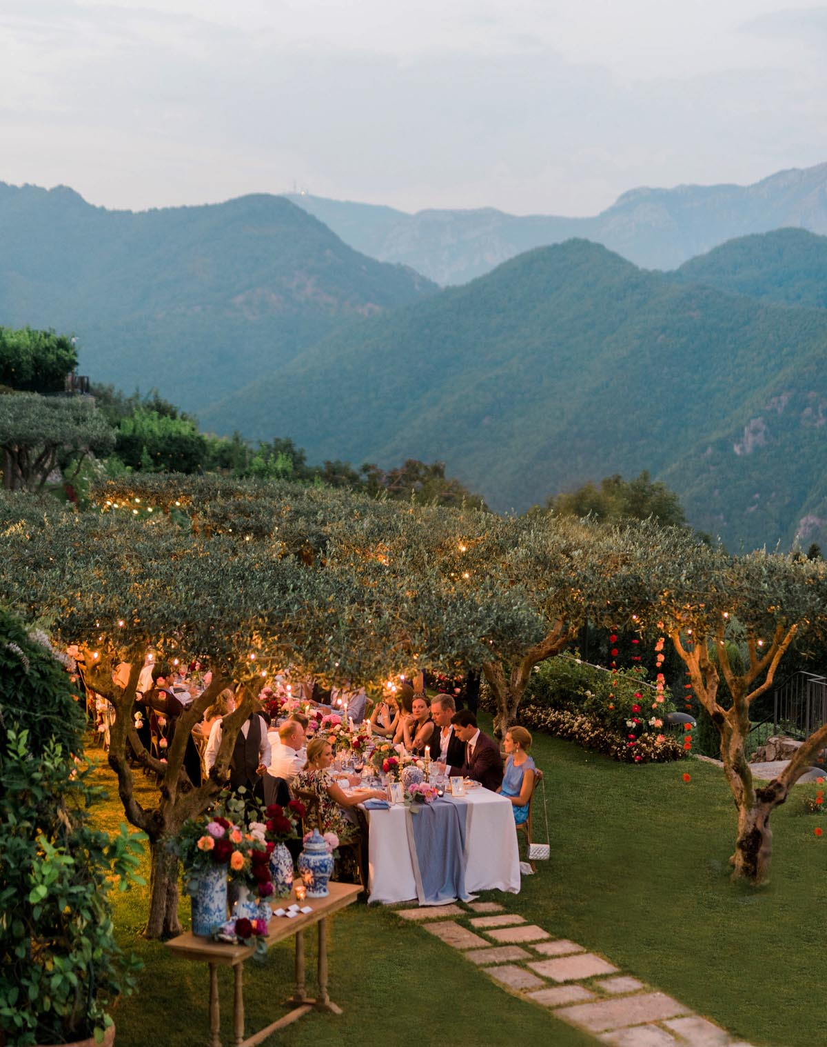Italy-wedding-tablescape-with-mountains-and-hanging-flowers-and-string-lights